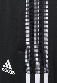 adidas Performance - TIRO - Tracksuit bottoms - black/white - 7