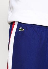Lacoste Sport - TRACKSUIT BOTTOMS - Pantalon de survêtement - blue - 3