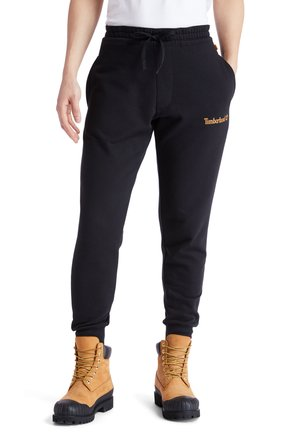 ESTABLISHED 1973 - Tracksuit bottoms - black-wheat boot