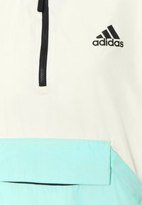 adidas Performance - Back-to-School W.R ANORK URBAN WIND.RDY OUTDOOR RELAXED JACKET - Windbreaker - cream white/clear mint - 6
