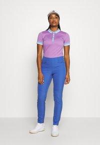 Kjus - WOMEN ELLA STRUCTURE - Polo shirt - pink divine/vista blue - 1