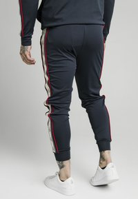 SIKSILK - PREMIUM TAPE CUFFED PANT - Tracksuit bottoms - navy - 2
