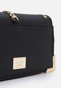 ALDO - Across body bag - jet black/light gold-coloured - 4