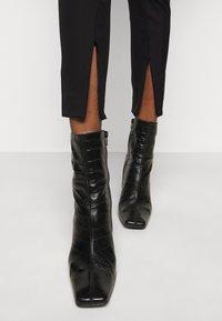 By Malene Birger - ADANIS - Trousers - black - 4