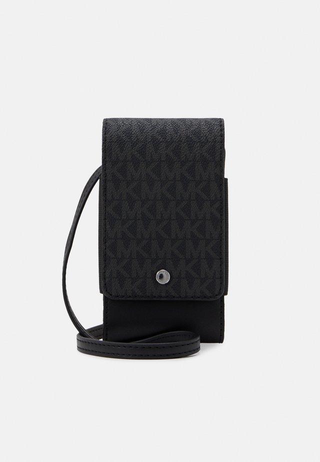 EXPANDABLE PHONE LANYARD UNISEX - Sac bandoulière - black