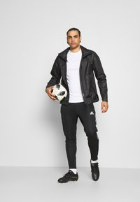 adidas Performance - TIRO 21 - Pantalon de survêtement - black - 1