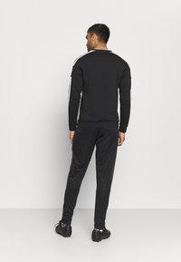 adidas Performance - TIRO  - Pantalon de survêtement - black - 2