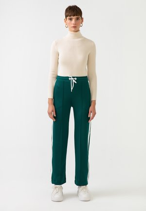 STRIPED  - Tracksuit bottoms - green