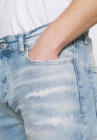Topman - BLEACH - Slim fit jeans - light wash - 4