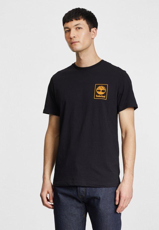 T-shirt con stampa - black/dark cheddar
