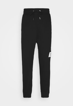PANT THE CREW - Tracksuit bottoms - nero