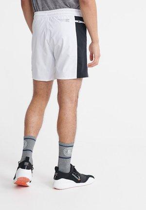 SUPERDRY TRAINING DOUBLE LAYER SHORTS - Shorts - white