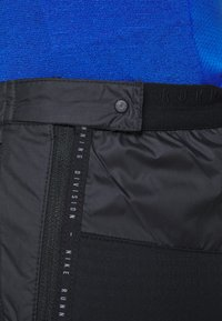 Nike Performance - SHIELD - Tracksuit bottoms - black/reflective silver - 5