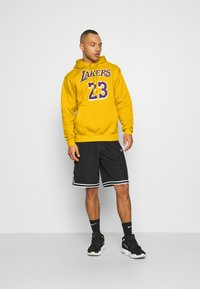 Nike Performance - NBA LOS ANGELES LAKERS LEBRON JAMES CITY EDITION ESSENTIAL - Club wear - amarillo/field purple - 1