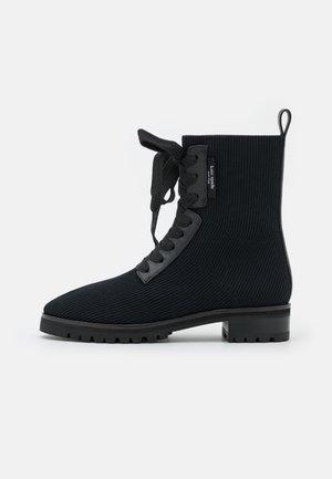 MERIGUE - Lace-up ankle boots - black