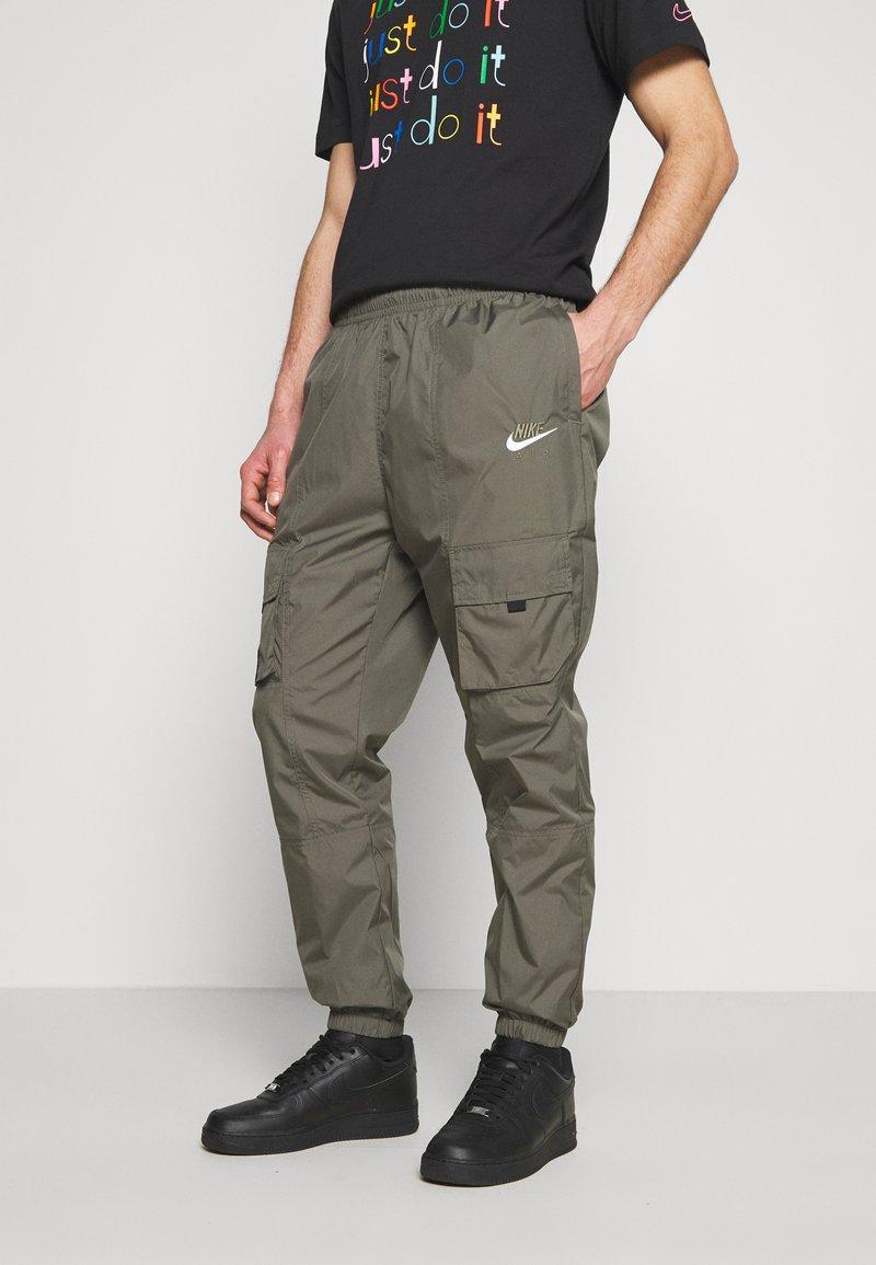 Nike Sportswear - AIR PANT  - Tracksuit bottoms - twilight marsh