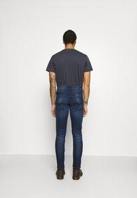 Pepe Jeans - CASH 5 PKT - Jeans slim fit - dark blue denim - 2