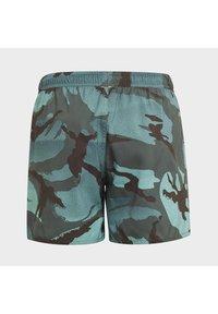 adidas Performance - Swimming shorts - green - 1