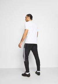 adidas Performance - TIRO 21 - Tracksuit bottoms - black/white - 2