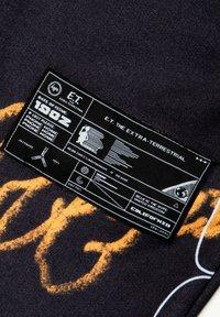 Hype - Tracksuit bottoms - orange/black - 6