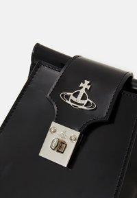 Vivienne Westwood - DOLCE PHONE CROSSBODY - Phone case - black - 3