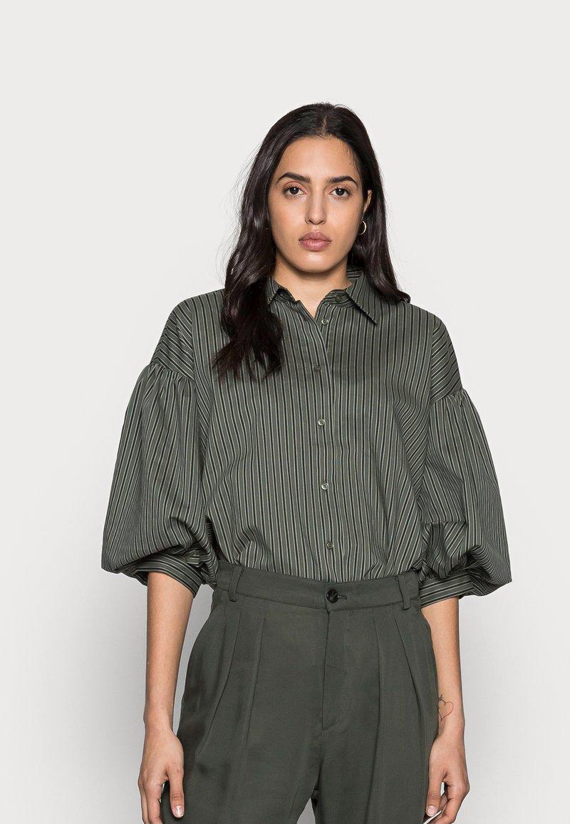 InWear - YOKO SHIRT - Button-down blouse - beetle green