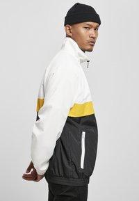 Starter - Summer jacket - white/black/golden - 3