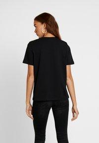 Vero Moda - VMPUKKA - T-shirt basique - black - 2