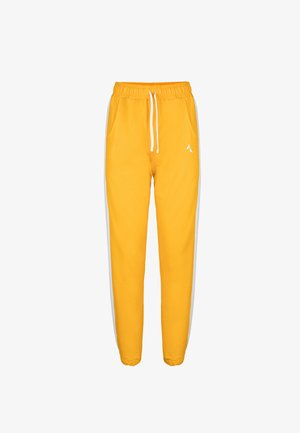 RELAXED SWEATPANTS - Tracksuit bottoms - yellow
