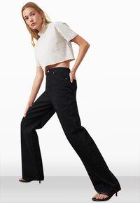 Trendyol - Flared Jeans - black - 2