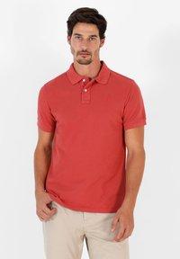 Scalpers - Polo shirt - terracotta - 0