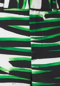 Stieglitz - RINA FLARE  - Bukse - white/green - 2