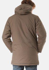 Carhartt WIP - Winter coat - beige - 1