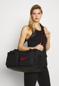 Nike Performance - UTILITY S DUFF - Sports bag - black/track red - 4