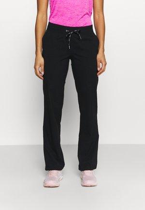 ESSENTIAL FLEX PANTS - Tracksuit bottoms - black