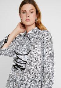 Sister Jane - POLKA RUFFLE BLOUSE - Button-down blouse - black/white - 3