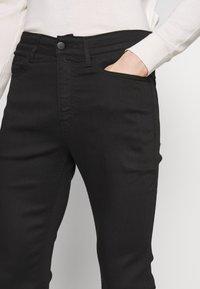 Calvin Klein Jeans - CKJ 016 SKINNY - Skinny džíny - black - 4