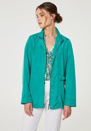 Vodotěsná bunda - verde