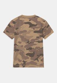 Guess - Print T-shirt - beige - 1