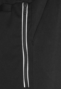 Nike Sportswear - TRIBUTE - Tracksuit bottoms - black/white - 5