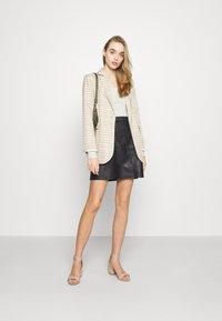 Vero Moda - VMPARIS SHORT SKIRT  - Mini skirt - black - 1