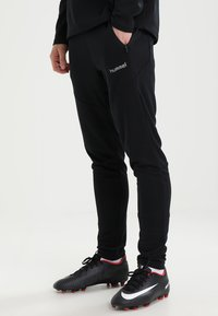 Hummel - TECH MOVE  - Tracksuit bottoms - black - 0