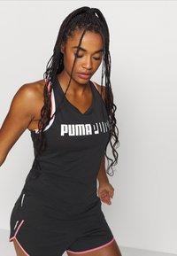 Puma - TRAIN LOGO CROSS BACK TANK - Funktionsshirt - black - 3