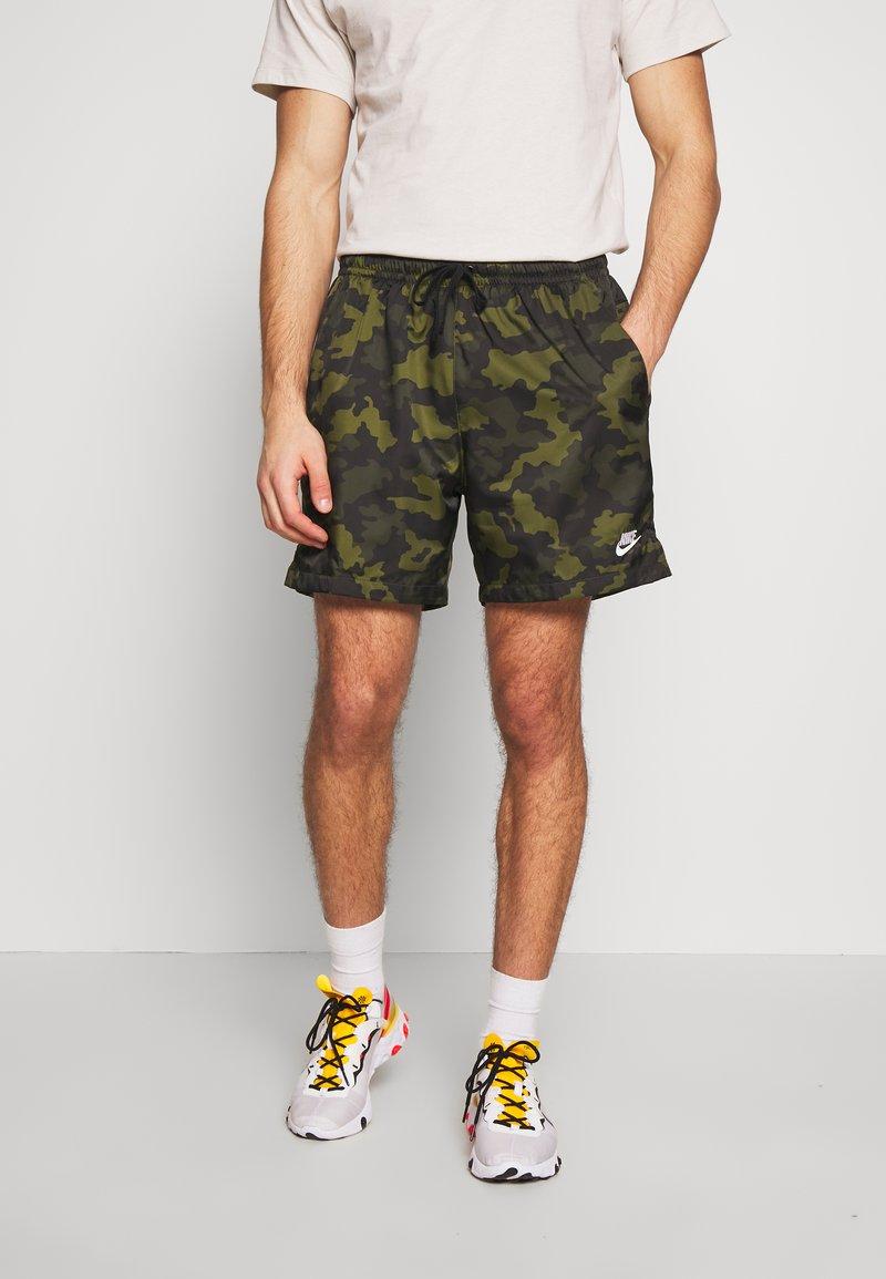 Nike Sportswear - FLOW  - Shorts - legion green/black/treeline