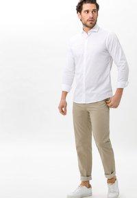 BRAX - Trousers - brown - 1