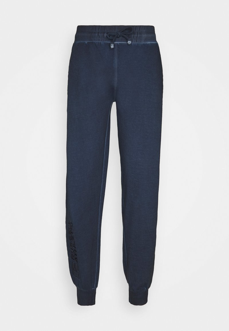 Russell Athletic Eagle R - AZAMAT - Tracksuit bottoms - navy