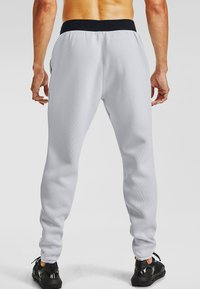 Under Armour - MOVE PANTS - Tracksuit bottoms - halo gray - 1