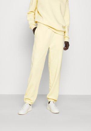 PLAY THINKTWICE - Teplákové kalhoty - yellow