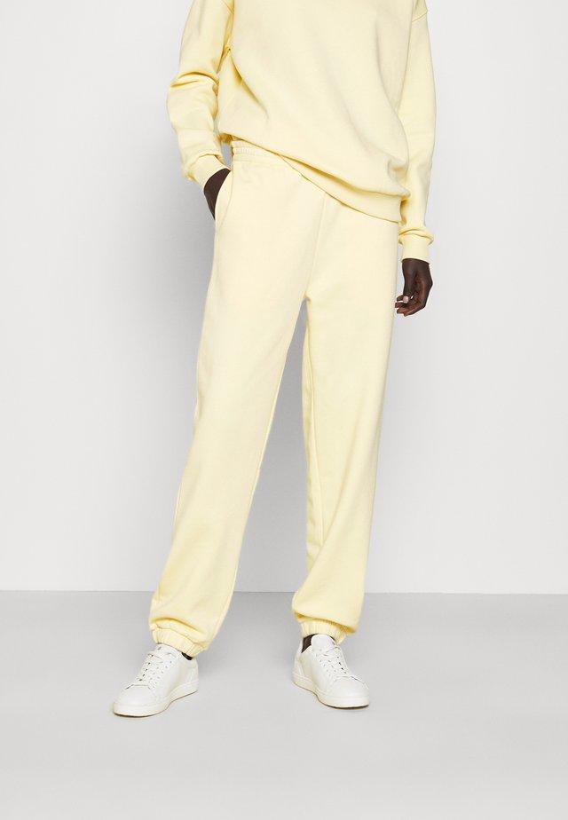 PLAY THINKTWICE - Spodnie treningowe - yellow
