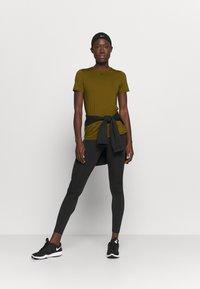 Nike Performance - ALL OVER - T-shirt basic - olive flak/black - 1